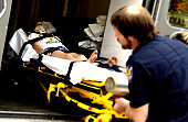 EMT loading patient into ambulance