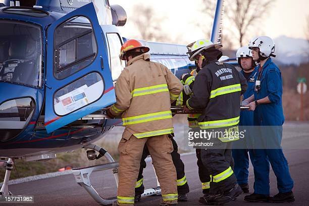Loading patient into helicopter
