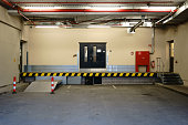 The loading ramp of a business building with fire safety equipment.