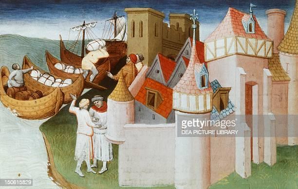 Loading spices onto ships for transportation miniature from Livre des merveilles du monde by Marco Polo and Rustichello manuscript 2810 folio 86...