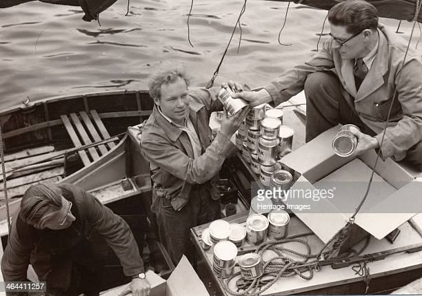 Loading yacht Forerunner with Rowntree Cocoa for a roundtheworld voyage 1954