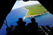February 23, 2011 - Loadmasters admire the view from the back of a C-130 Hercules over Tumon Bay, near Guam, during Exercise Cope North.
