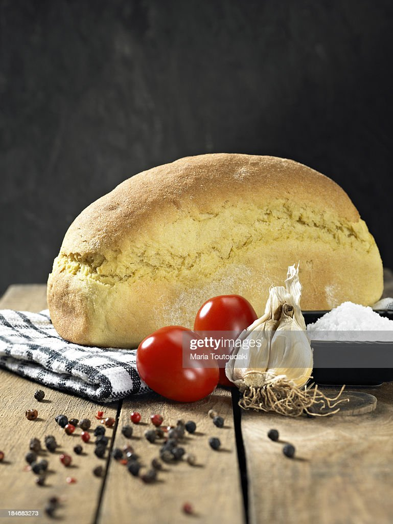 Loaf of bread, tomatoes and garlic : Stock Photo