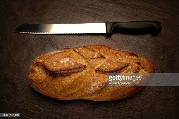 Loaf of bread with a bread knife