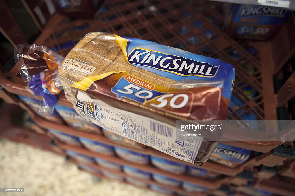 A loaf of Kingsmill 50/50 bread, produced by Associated British Foods Plc, sits in a crate at a supermarket in London, U.K., on Monday, Nov. 5, 2012. AB Foods shares have gained 17 percent this year, fueled by the growth of the sugar unit and Primark, the company's two main profit contributors. Photographer: Simon Dawson/Bloomberg via Getty Images