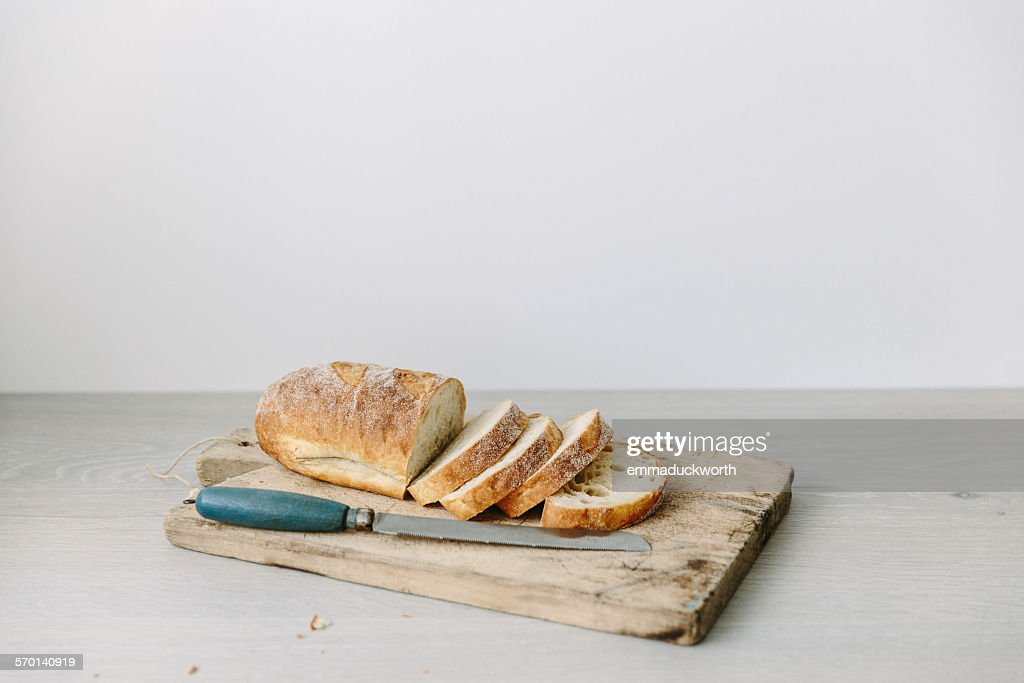 Loaf of sliced bread on a chopping board : Stock Photo