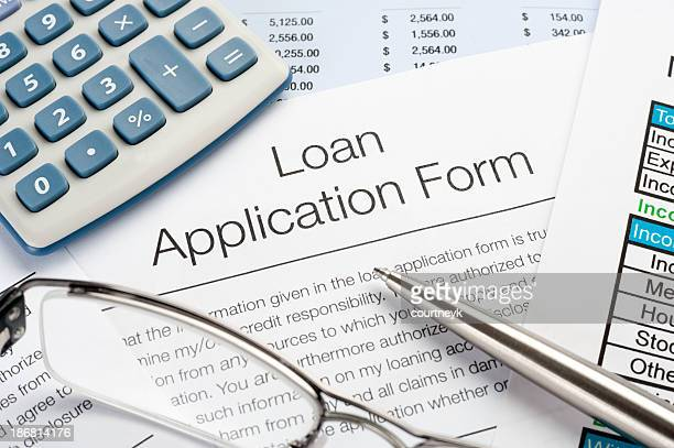 Loan Application Form with pen, calculator