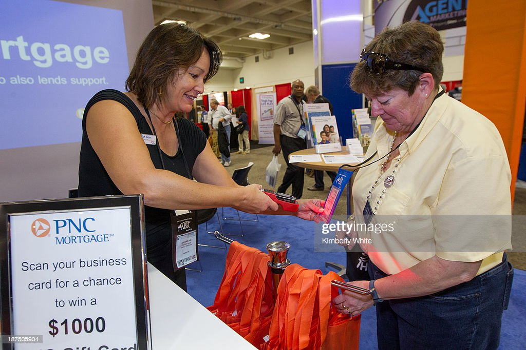 PNC Loan Officers Attend To Customers At Their Booth During The National  Association Of Realtos At