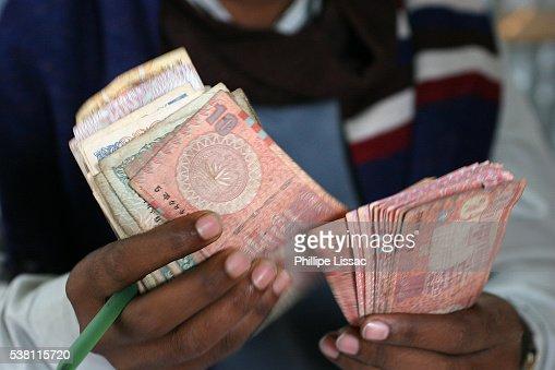 Loan Reimbursement at Grameen Bank Borrowers' Meeting