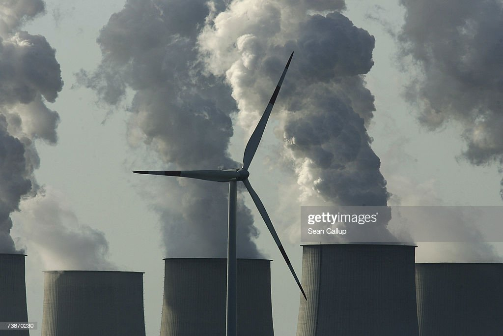 A loan wind turbine spins as exhaust plumes from cooling towers at the Jaenschwalde lignite coal-fired power station, which is owned by Vatenfall, April 12, 2007 at Jaenschwalde, Germany. Germany is planning the construction of 40 new coal-fired power plants, though officials claim the plants are based on technology that radically increases their efficiency. The Jaenschwalde power plant, built by the former East German government in the 1980s, emits 25 million tons of CO2 annually and is among the biggest single producers of CO2 emissions in Europe.