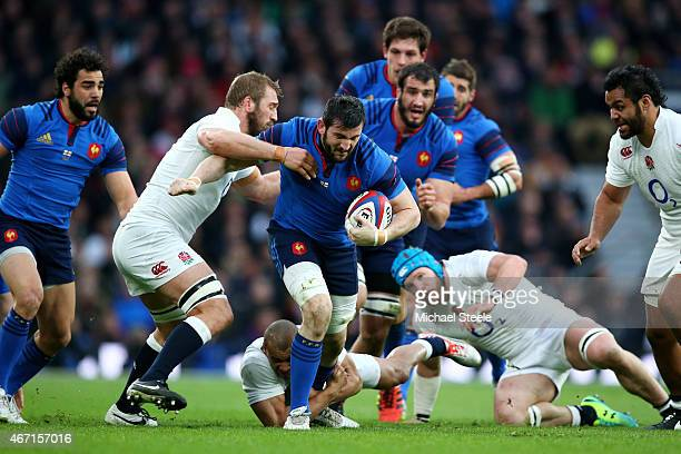 Loann Goujon of France is tackled by Chris Robshaw of England during the RBS Six Nations match between England and France at Twickenham Stadium on...