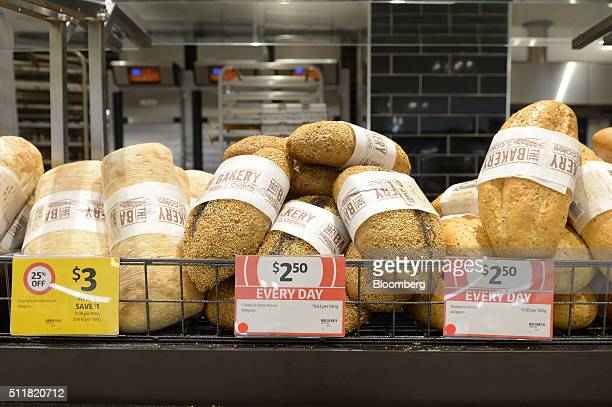 Loaves of bread are displayed for sale in the bakery section of a Coles supermarket operated by Wesfarmers Ltd in Melbourne Australia on Tuesday Feb...