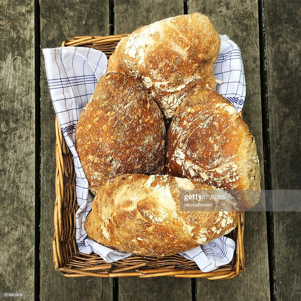Loaves of bread in a basket : Stock Photo