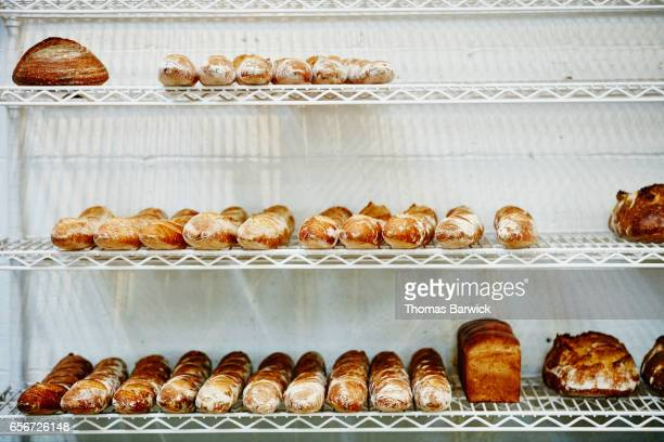 Loaves of bread on cooling rack in bakery
