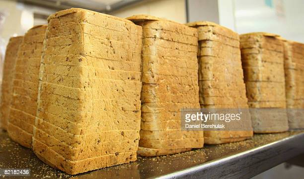 Loaves of bread wait to be packaged at the Bread Factory on August 5 2008 in London England Many bakeries are feeling the pinch with the rising cost...