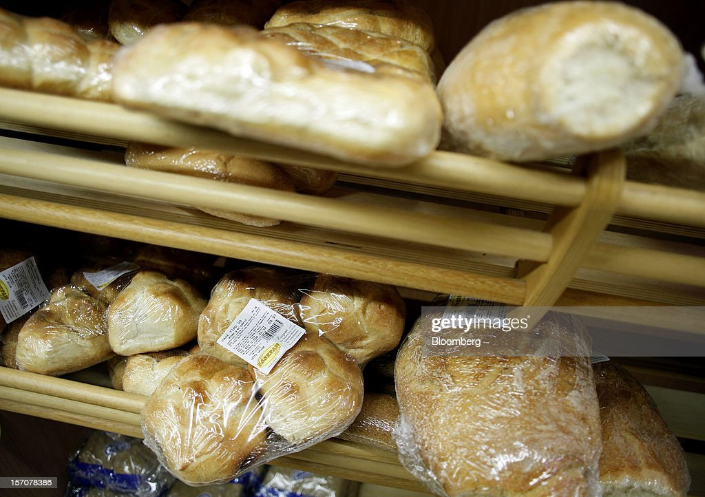 Loaves of fresh bread are displayed for sale in the bakery section of a OnePrice supermarket, operated by Gruppo BSE, in Monterotondo, Italy, on Wednesday, Nov. 28, 2012. Italy needs to uphold Prime Minister Mario Monti's pledge to shore up public finances in order to enjoy investor confidence even after elections due by April, the Organization for Economic Cooperation and Development said in its latest Economic Outlook report this week. Photographer: Alessia Pierdomenico/Bloomberg via Getty Images