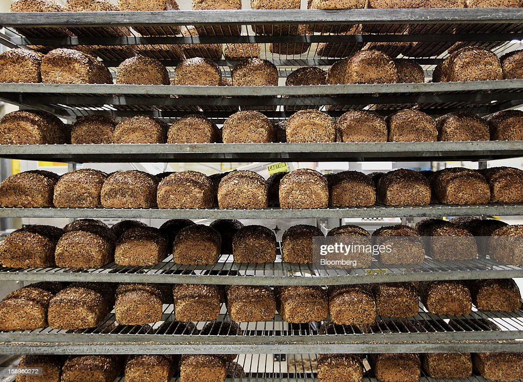 Loaves of freshly baked organic bread await packaging and shipping at Dave's Killer Bread bakery in Milwaukie, Oregon, U.S., on Friday, Jan. 4, 2013. Goode Partners, a private equity firm specializing in growth investments in the branded consumer products sectors, has purchased a fifty percent stake in Dave's Killer Bread which will help the company expand into new markets around the country. Photographer: Natalie Behring/Bloomberg via Getty Images
