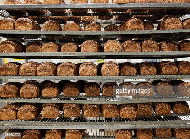 Loaves of freshly baked organic bread await packaging and shipping at Dave's Killer Bread bakery in Milwaukie Oregon US on Friday Jan 4 2013 Goode...
