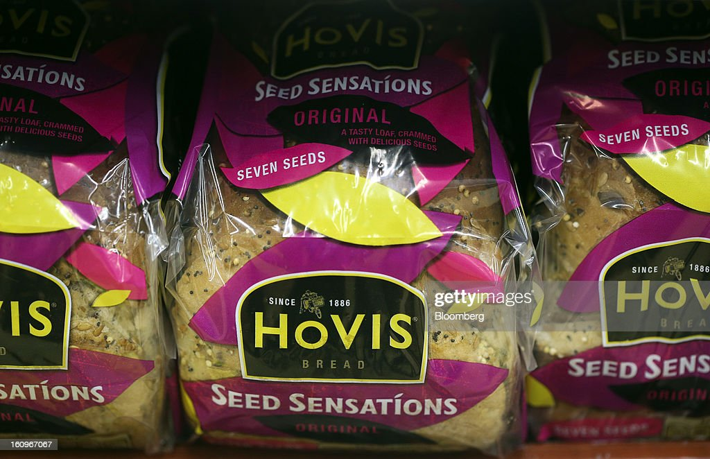 Loaves of Hovis seeded bread, produced by Premier Foods Plc, sit on a shelf inside a supermarket in London, U.K., on Friday, Feb. 8, 2013. Britain's economy will grow more slowly this year than previously forecast and stagnation may persist, according to the National Institute of Economic and Social Research. Photographer: Chris Ratcliffe/Bloomberg via Getty Images