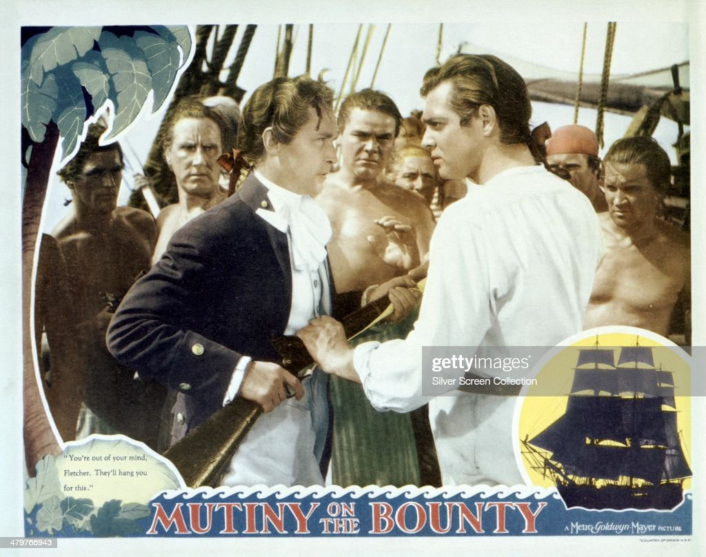 A lobby card for Frank Lloyd's 1935 historical drama 'Mutiny On The Bounty', featuring <a gi-track='captionPersonalityLinkClicked' href=/galleries/search?phrase=Franchot+Tone&family=editorial&specificpeople=214212 ng-click='$event.stopPropagation()'>Franchot Tone</a> (left) as Byam, and <a gi-track='captionPersonalityLinkClicked' href=/galleries/search?phrase=Clark+Gable&family=editorial&specificpeople=70015 ng-click='$event.stopPropagation()'>Clark Gable</a> (right) as Fletcher Christian.