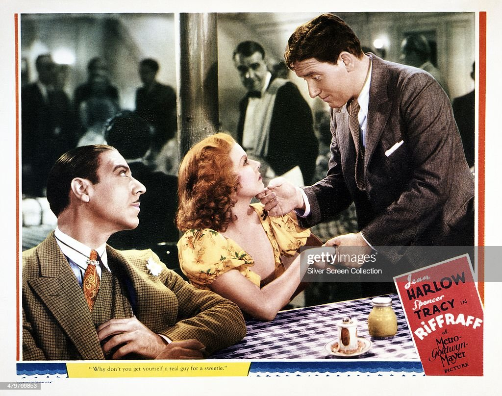 A lobby card for J Walter Ruben's 1936 crime drama 'Riffraff' featuring Joseph Calleia Jean Harlow and Spencer Tracy in a scene from the film