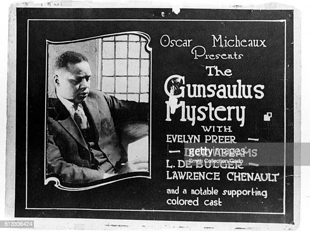 A lobby card for the 1921 silent film 'The Gunsaulus Mystery' the poster features Oscar Micheaux who was the writer and director of the film he is...