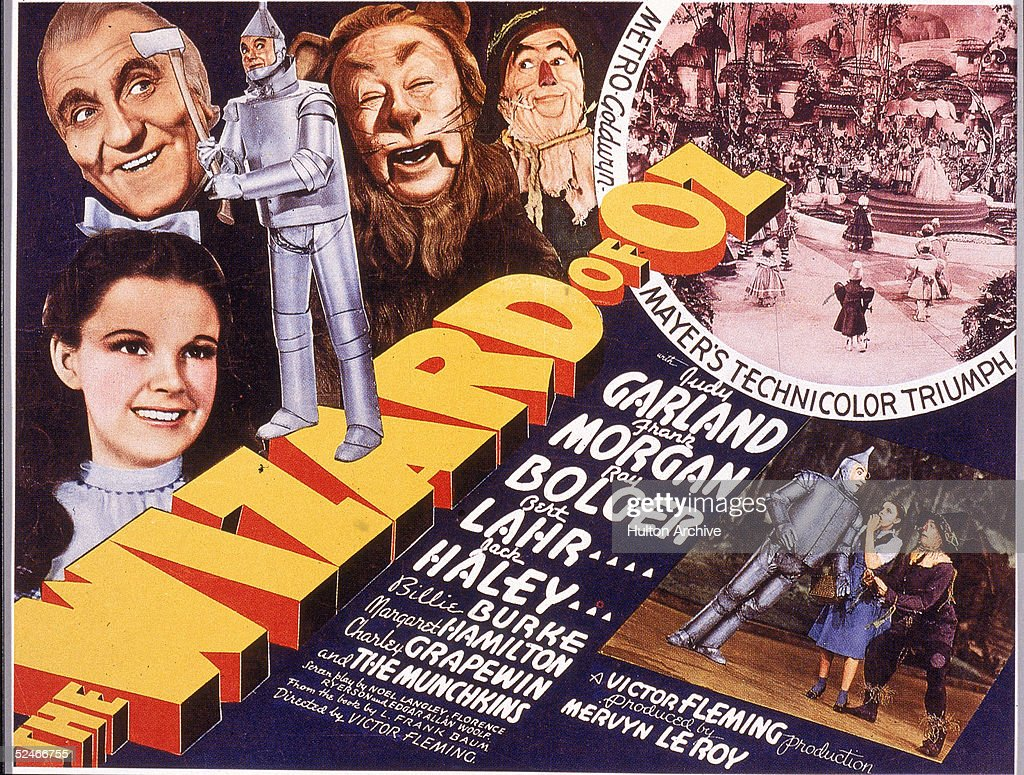 A lobby card from the film 'The Wizard Of Oz,' shows an illustration of American actress Judy Garland (1922 - 1969) (as Dorothy) and, left to right, actors Frank Morgan (1890 - 1949) (as the Wizard), Jack Haley (1898 - 1979) (as the Tin Man), Bert Lahr (1895 - 1967) (as the Cowardly Lion), and Ray Bolger (1904 - 1987) (as the Scarecrow), 1939. Several scenes from the film, which was directed by Victor Fleming, are also visible.