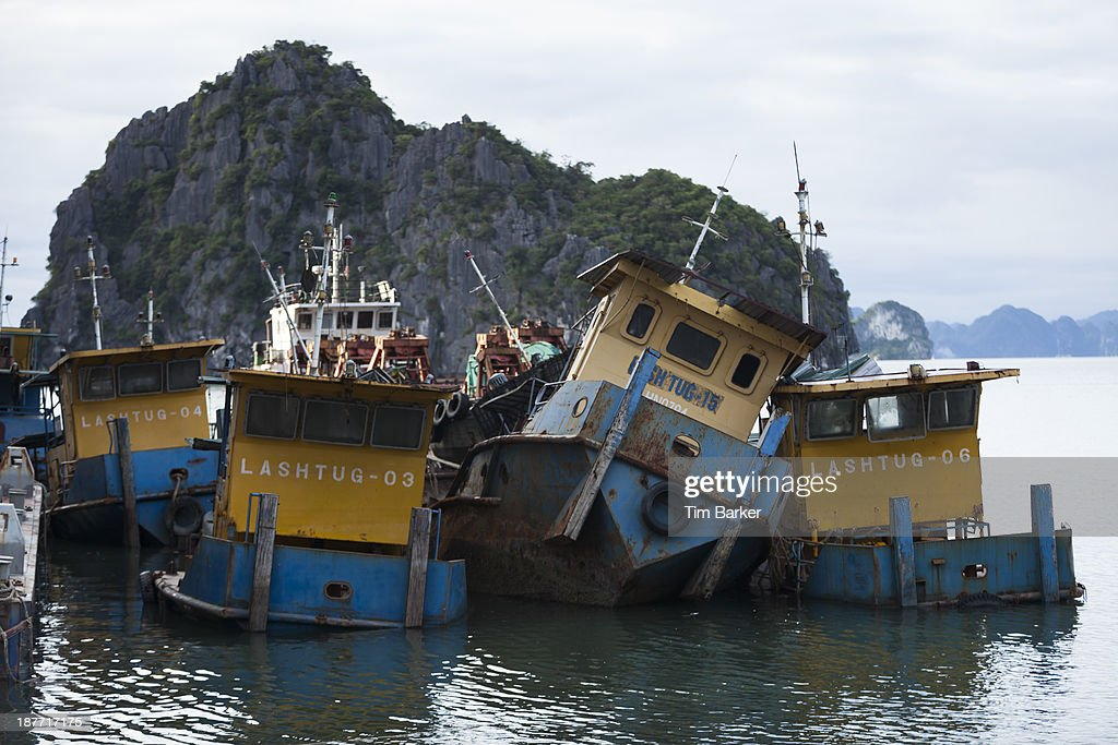 A lobsided boat is seen in the bay on the morning after Typhoon Haiyan made landfall on November 12 2013 in Halong City Vietnam Typhoon Haiyan which...