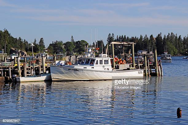 Lobster boat at dock waterfront Vinalhaven Island Maine New England USA