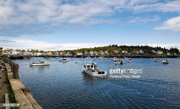 A lobster boat enters Carver's Harbor on Vinalhaven on Wednesday May 21 2014 The fishing fleet on Vinalhaven which is 12 miles offshore is one of the...