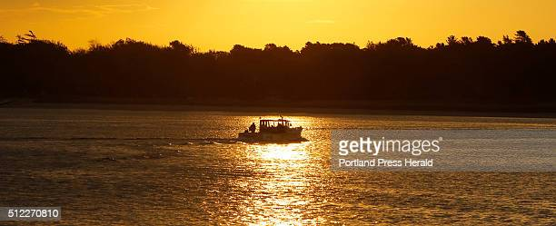 A lobster boat heads out to sea at Pine Point in Scarborough on Lobsterman on Wednesday October 21 2015 Warming temperatures and increased acidity in...