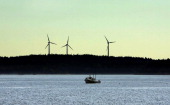 A lobster boat plies the waters off Vinalhaven where three wind turbines which came on line five years ago are still causing controversy Residents...