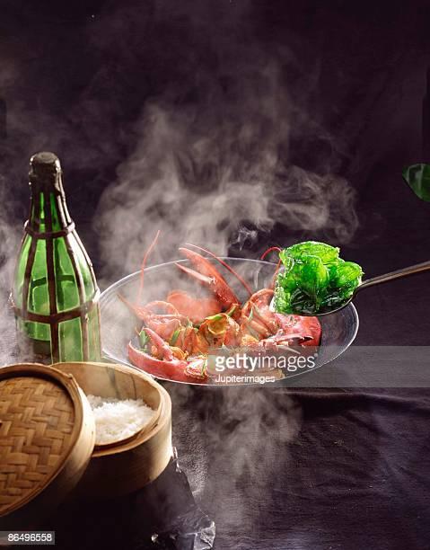Lobster cooking in wok