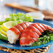 lobster dinner with lemon and lettuce for a garnish