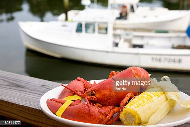 Lobster dinner with motor boat on background