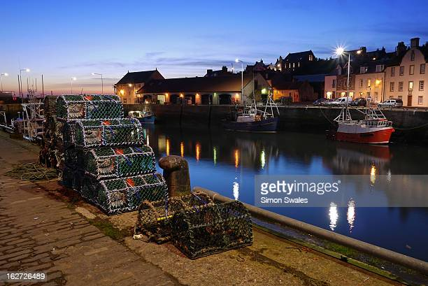 Lobster pots on the harbour at dusk