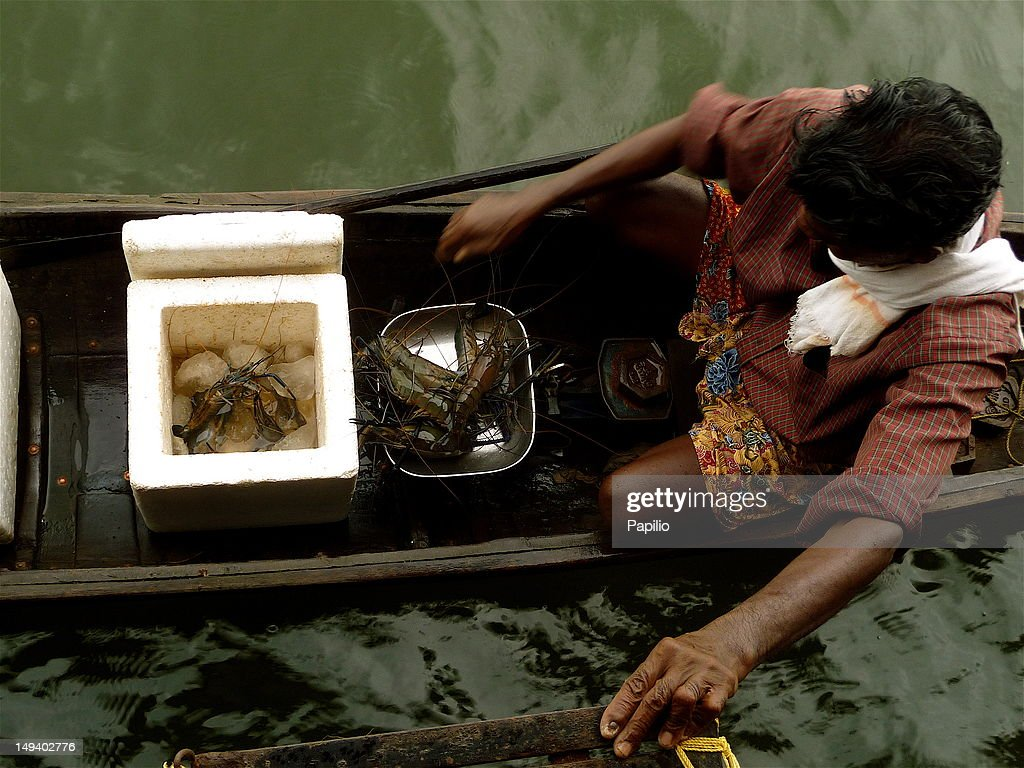 Lobster seller on boat : Stock Photo