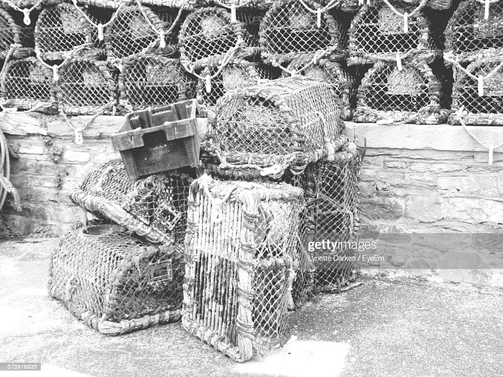 Lobster Traps On Wall And Footpath