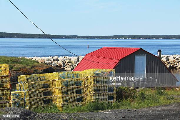 Lobster traps piled in front of fisherman's dwelling or shed in Blue Rocks, Nova Scotia