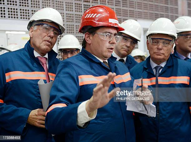 Loïc Maenner director of Rio Tinto factory talks with French Prime minister JeanMarc Ayrault and French Minister for Industrial Renewal and Food...