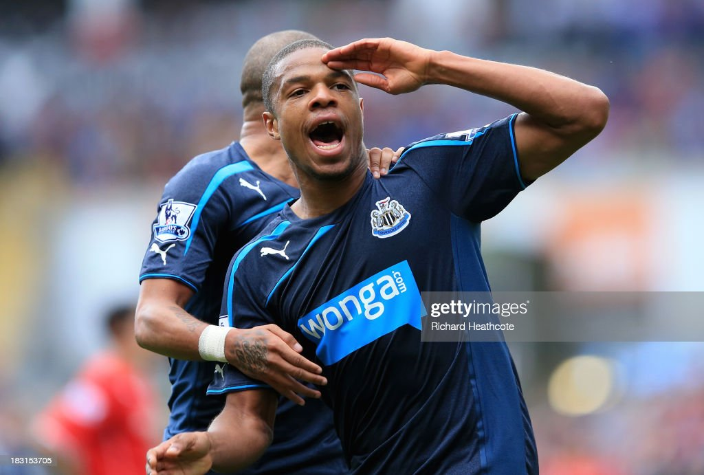 Loïc Rémy of Newcastle United (Front) celebrates with team-mate <a gi-track='captionPersonalityLinkClicked' href=/galleries/search?phrase=Yoan+Gouffran&family=editorial&specificpeople=534470 ng-click='$event.stopPropagation()'>Yoan Gouffran</a> after scoring his first goal during the Barclays Premier League match between Cardiff City and Newcastle United at Cardiff City Stadium on October 5, 2013 in Cardiff, Wales.