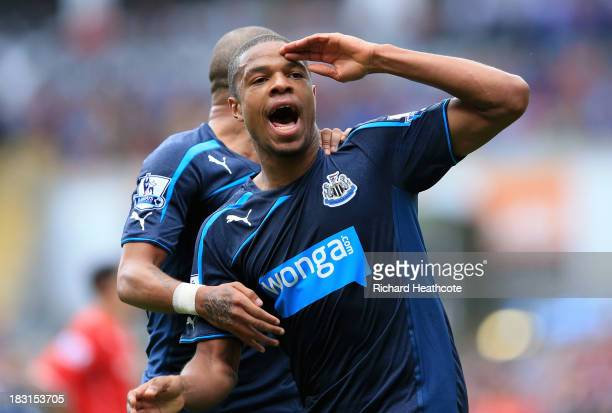 Loïc Rémy of Newcastle United celebrates with teammate Yoan Gouffran after scoring his first goal during the Barclays Premier League match between...