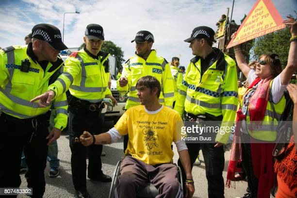 12 local activists locked themselves in specially made arm tubes to block the entrance to Quadrilla's drill site in New Preston Road July 03 2017...