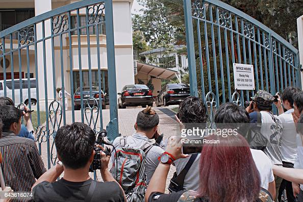 Local and international journalists scramble to get information from an unidentified man as he exits the North Korean Embassy compound on February 22...