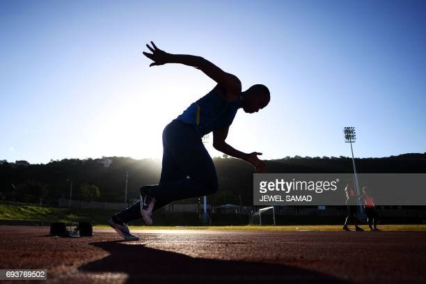 TOPSHOT Local athletes train in an outfield track at the national stadium in Kingston Jamaica on June 8 2017 Usain Bolt's imminent retirement is a...