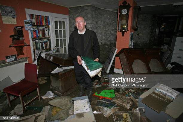 Local Auctioneer Pat O'Donovan surveys the damage to his offices in Newcastle West Co Limerick after the River Arra burst its banks last night