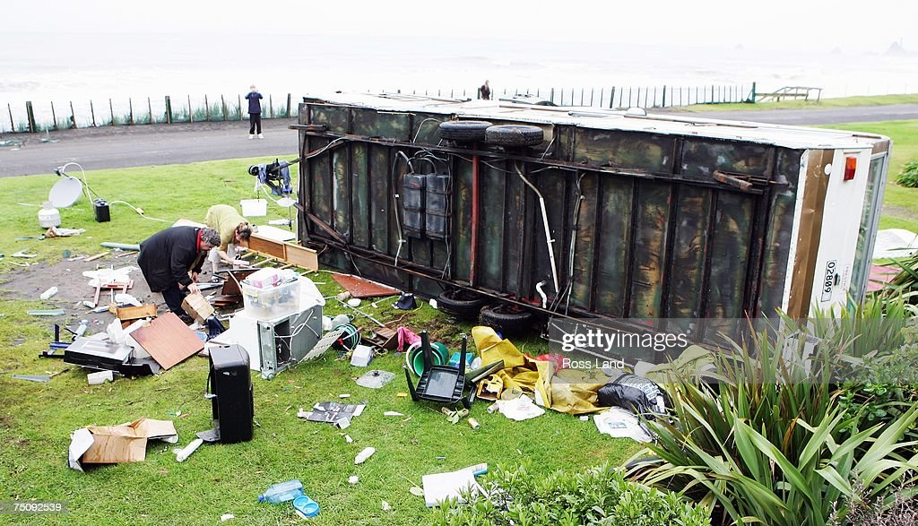 Local beach camp resident Norm Forth returns to his overturned caravan on July 6 2007 in the seaside town of Oakura south west of New Plymouth New...