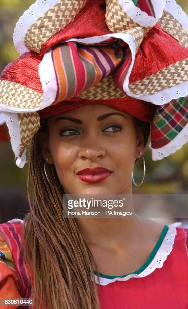 A local beauty in traditional costume who welcomed Queen Elizabeth II to a cultural display at Kings House Kingston Jamaica as part of the Queen's...