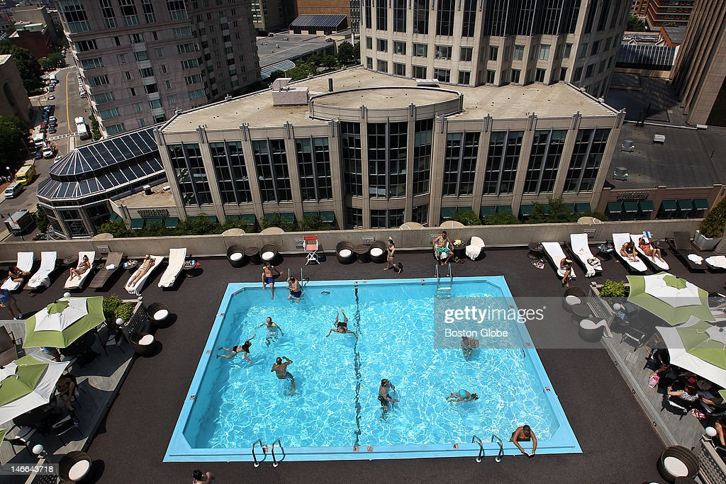 Local Bostonians keep cool on the rooftop of the Colonnade Hotel.