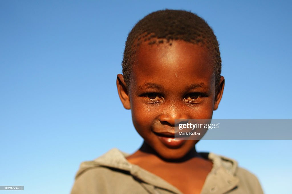 A local boy poses at Lawaaikamp township on June, 2010 in George, South Africa.